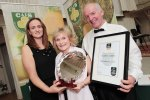 Mount Leinster Clothbound by Coolattin Cheddar named the Supreme Champion at the Irish Cheese Awards 2015.  Eilis Broderick pictured presenting Fiona and Tom Burgess of Coolattin Cheese with their award