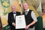 Clifford Webb of La Rousse pictured presenting the Class 9 Award, Pressed Cheese, Aged 3 Months Plus, All Milks, to Dicky Willems of Coolea Cheese for their Coolea Matured