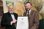 Clifford Webb of La Rousse pictured presenting the Class 10 Award, Pressed Cheese, Flavour Added, All Milks, to Frank Shinnick of Fermoy Natural Cheese for their St. Brigid with Herbs cheese