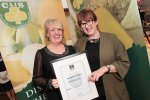 Grainne Whalley of the Traditional Cheese Company pictured presenting the Class 11 Award, Smoked Cheese, All Milks, to Jeffa Gill of Durrus Cheese for their Smoked Mini